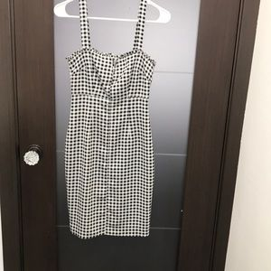 Likely gingham dress with zipper down back